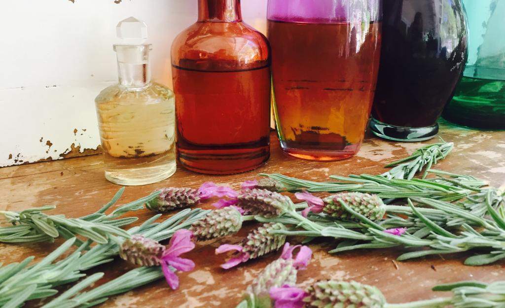 The rarest type of hemp oil is hemp essential oil. Photo: Hemp Essential Oil in bottles with hemp leaves.
