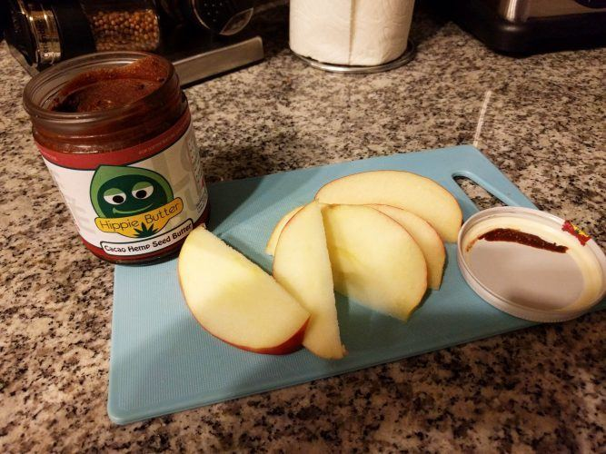 Spreading Cacao Hemp Butter on Apples