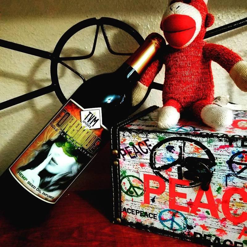 sock monkey with TVM hemp wine