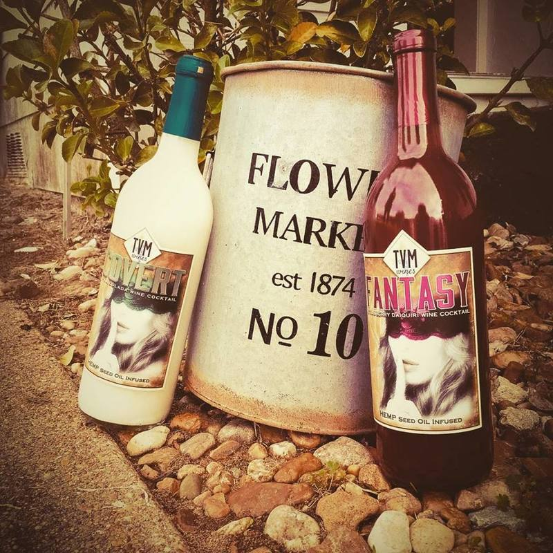two bottles of TVM hemp wine posed outdoors