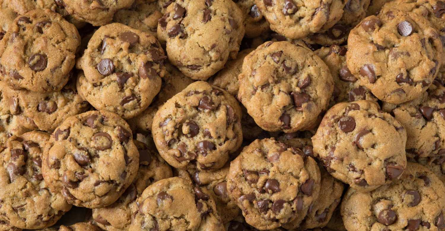 Photo shows a massive pile of chocolate chip cookies. From sweet to savory, CBD cooking doesn't have to be complicated.