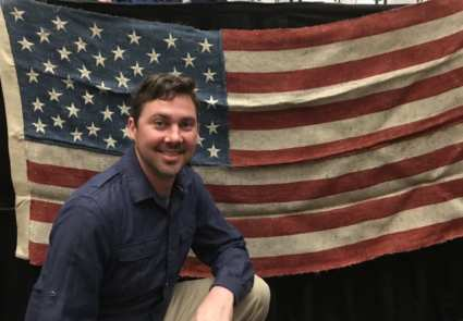 Anavii Market founder Jason Amatucci poses with a U.S. flag hand-sewn from hemp.