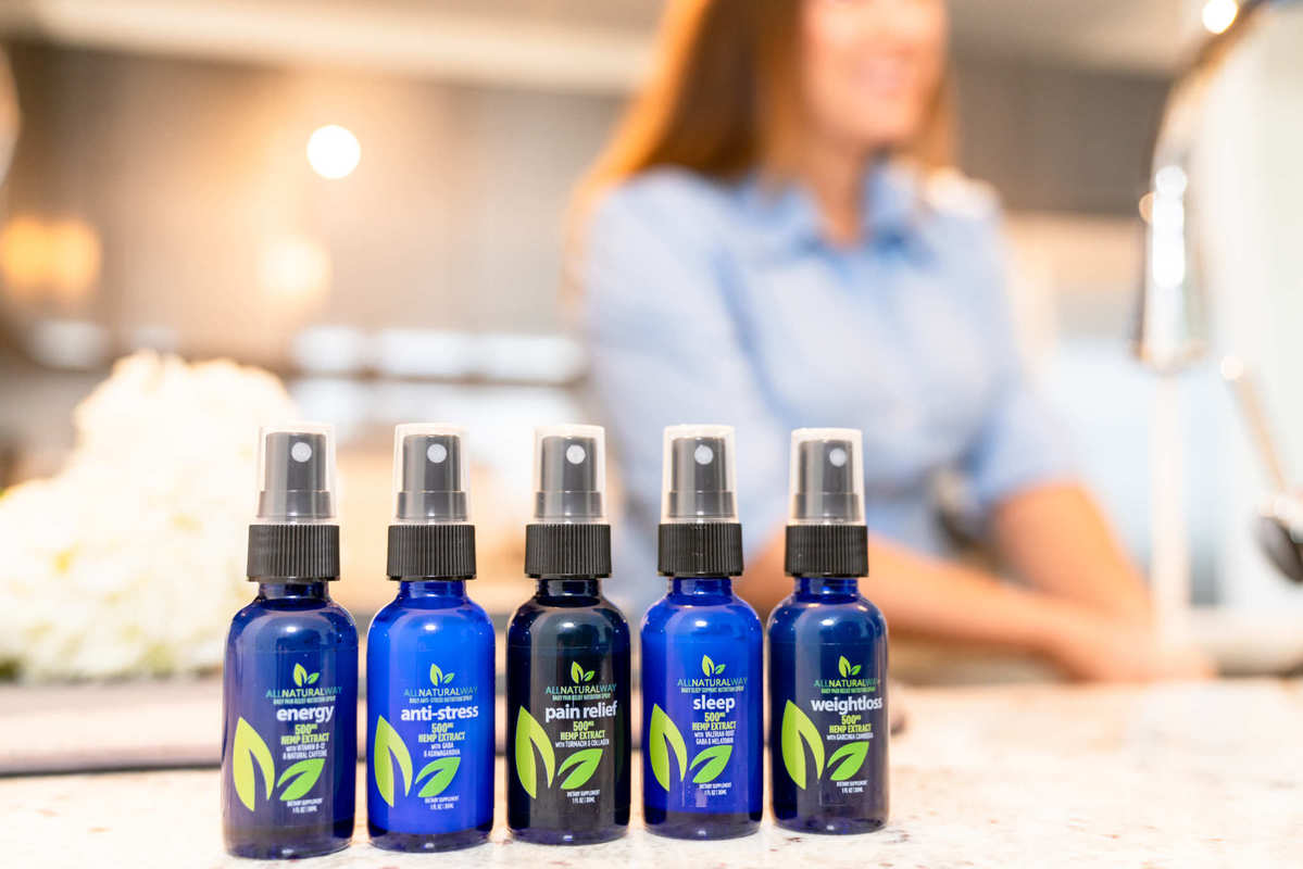 A line-up of All Natural Way CBD products on a kitchen counter. All Natural Way CBD Sleep Spray is part of a full line of specialized sprays.