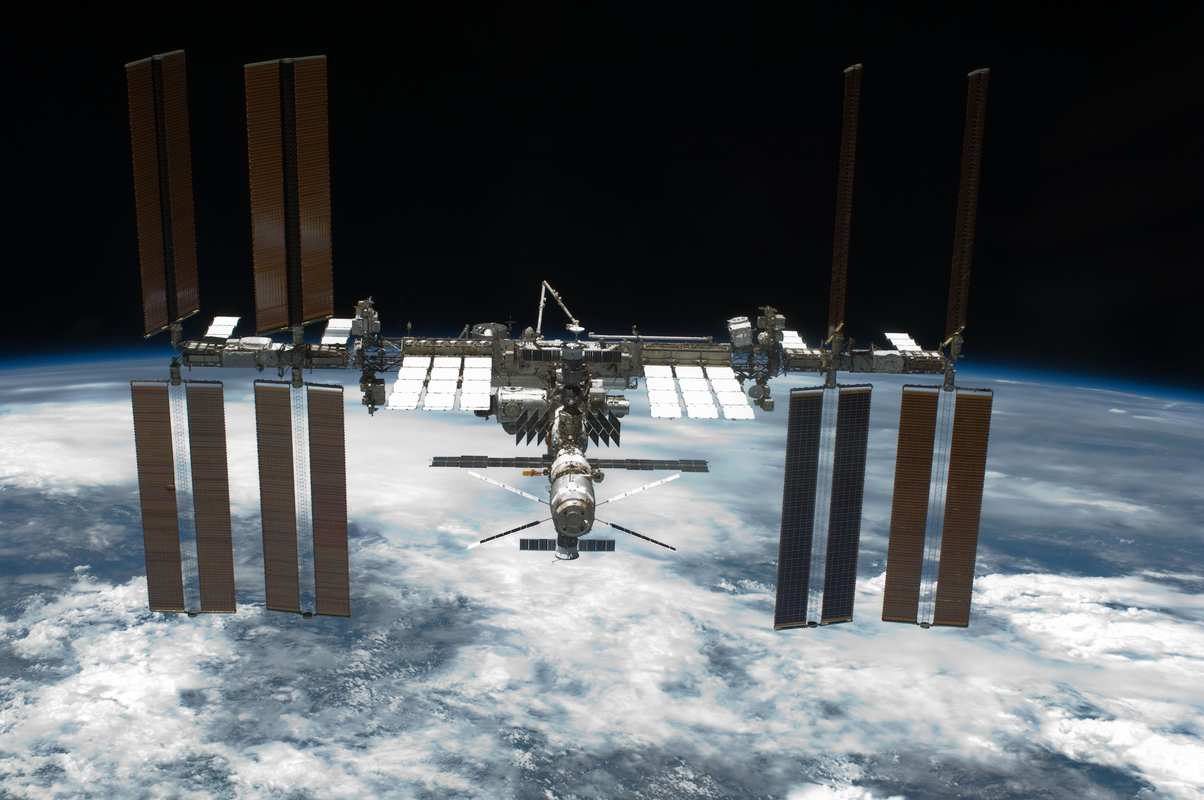 A photo of the International Space Station in orbit over earth, Space Tango and Anavii Market will soon begin experimenting with the immense potential of growing hemp in space.