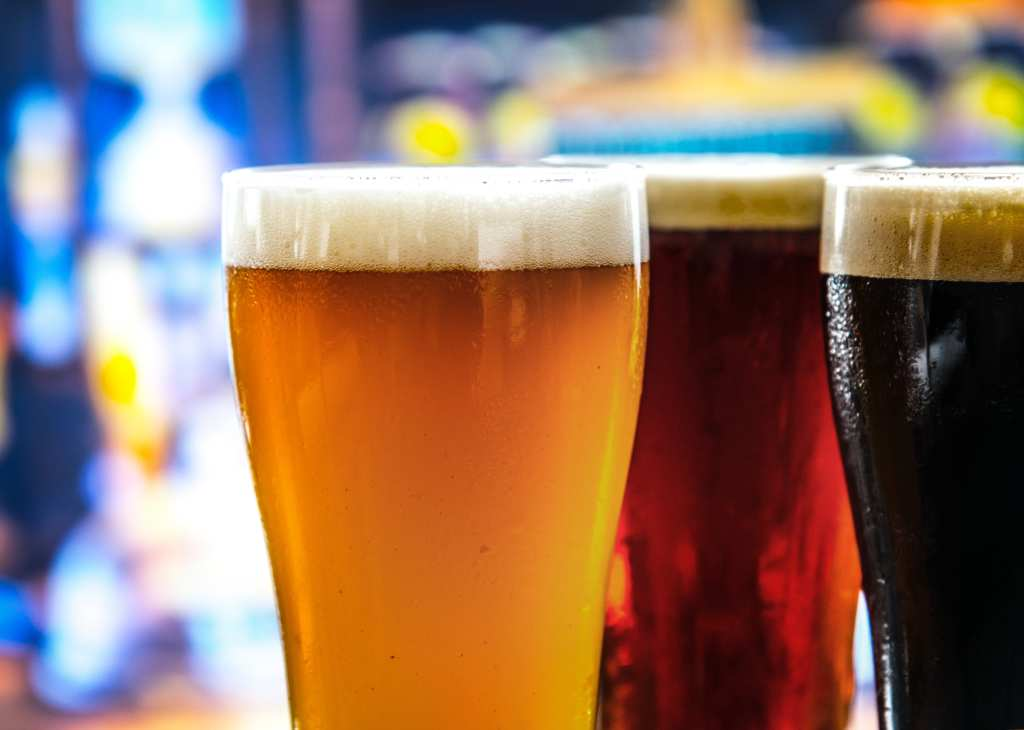 A photo showing three different beers of different colors in pint glasses. It's not just New Belgium: craft hemp beer is increasing in popularity.