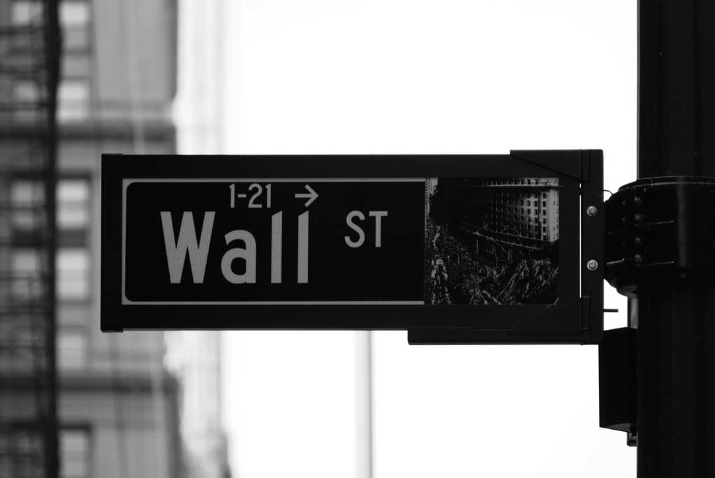 The Wall Street road sign in New York City, New York. In this article, we lay out some basics of investing in hemp stocks. Be careful: We're not investment experts, and can only get you started doing your own research!