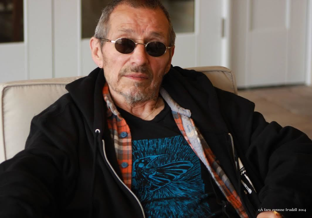 John Trudell, wearing sunglasses, smiles at the camera. Hemp activist John Trudell co-founded Hempstead Project Heart with musician Willie Nelson, before passing leadership of the organization to Marc Grignon in his final days.