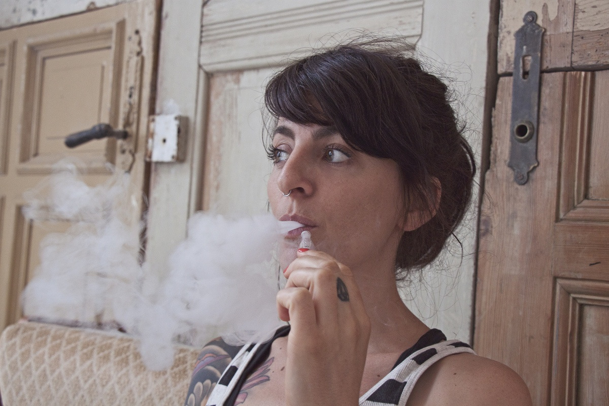 A woman exhales vapor after using a CBD vape. After doing her research CBD, Haddayr Copley-Woods discovered that vaping CBD offered instant and profound relief to symptoms of anxiety caused by Complex PTSD.
