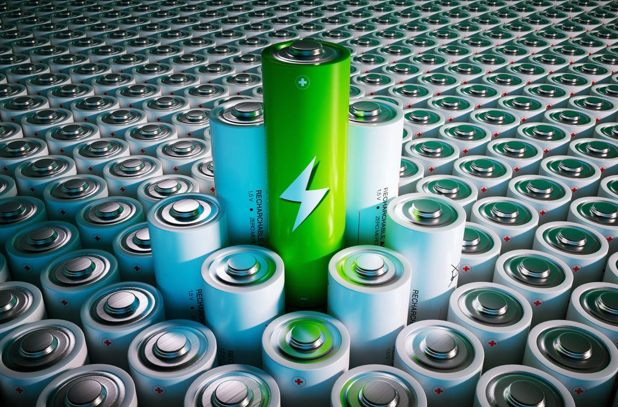 An illustration of a seemingly infinite number of batteries, with a small cluster rising above the others. A green colored battery is higher than the rest.