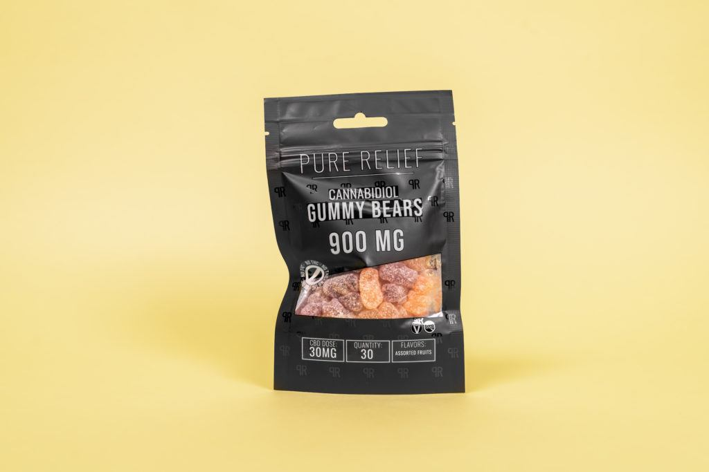 A bag of Pure Relief Pure Hemp Bears CBD Gummies against a solid yellow background.