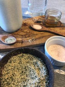 A kitchen counter covered with the ingredients to our DIY hemp milk including salt and hemp hearts.