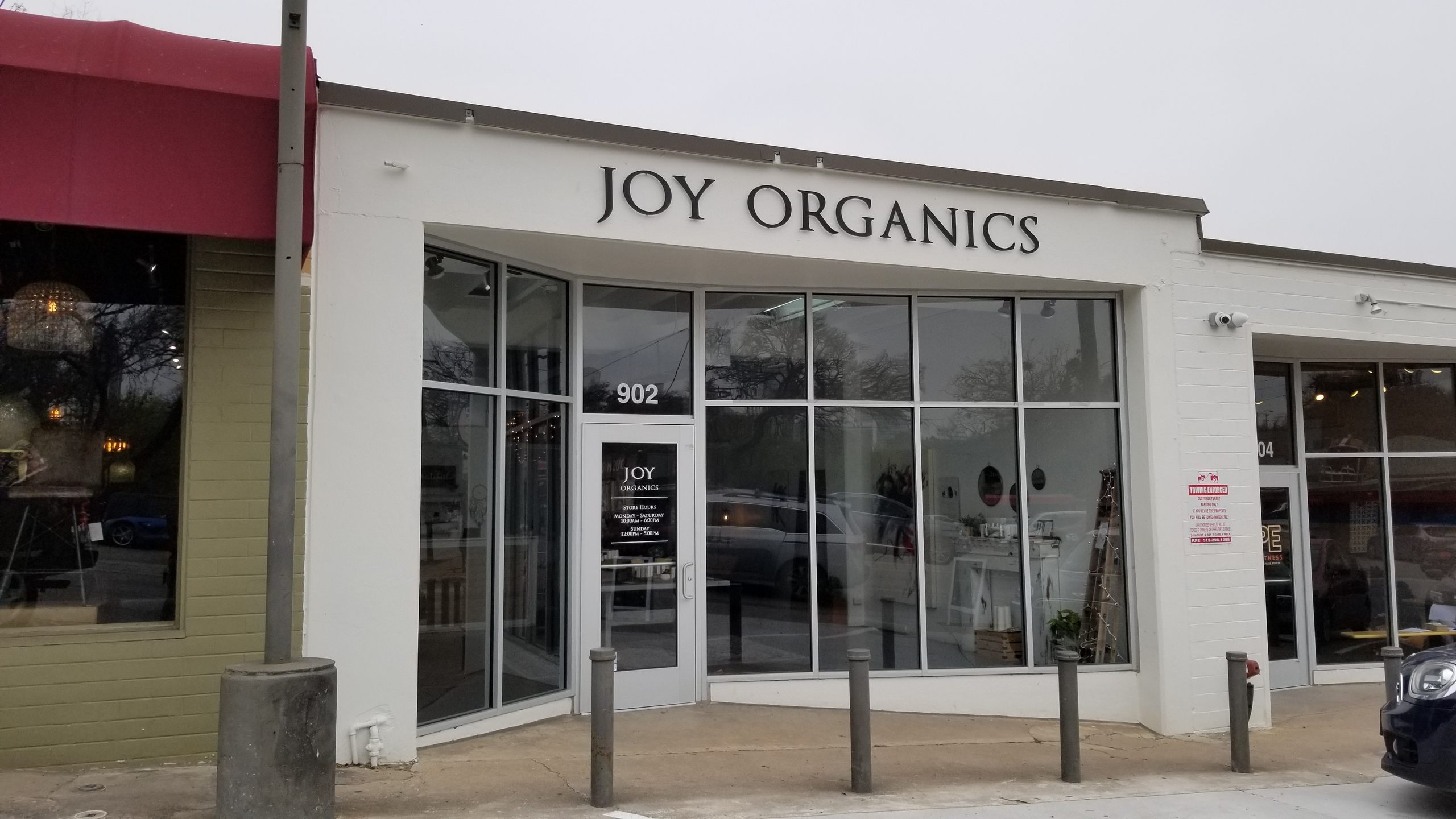 "The exterior of Joy Organics Austin store under a overcast sky. In our first ""Spotlight"" video, we visited the Joy Organics store in Austin, Texas to learn more about buying the right CBD."