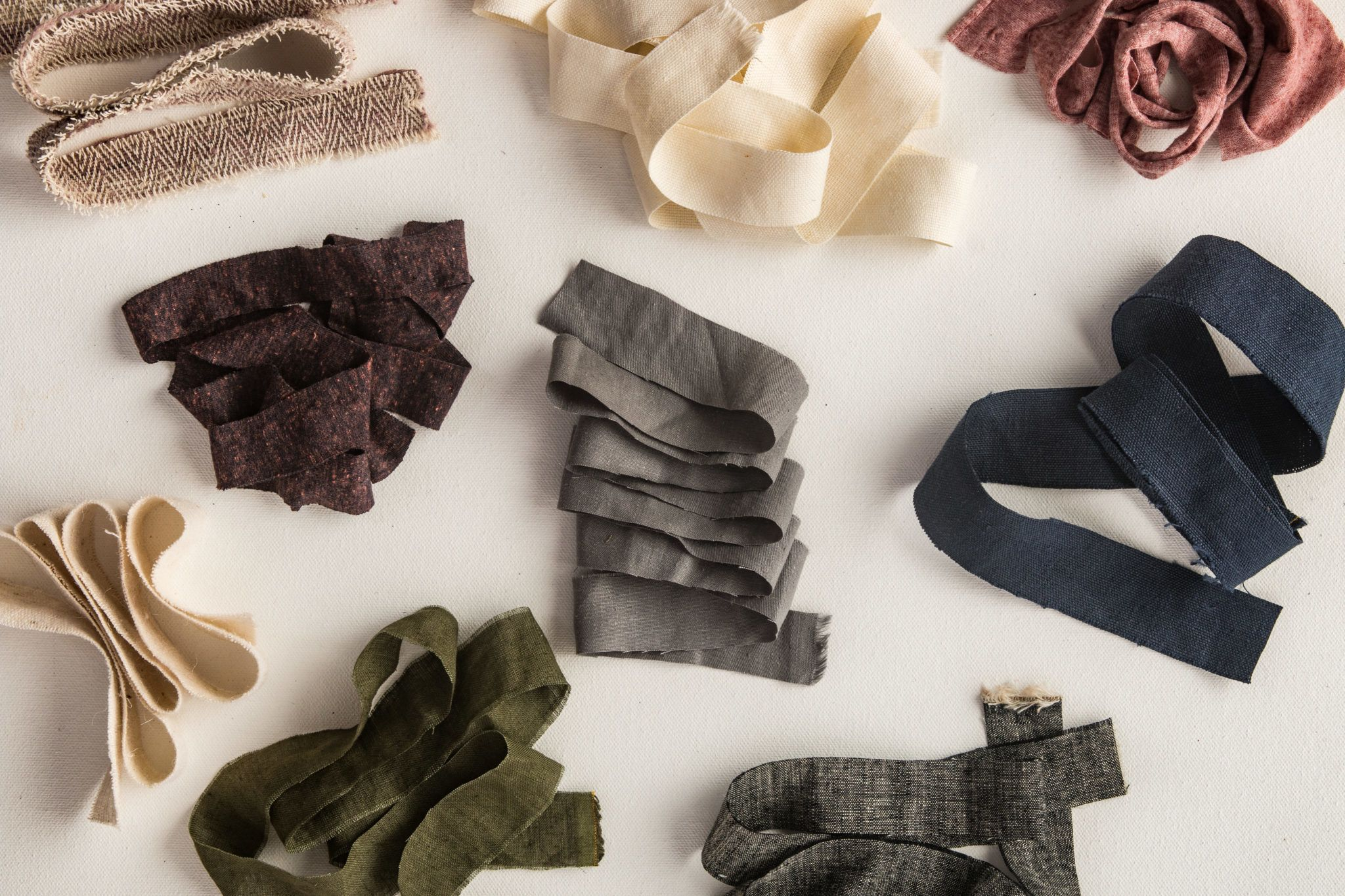 A collection of hemp fabric in a variety of colors and textures from Hemp Fabric Lab.
