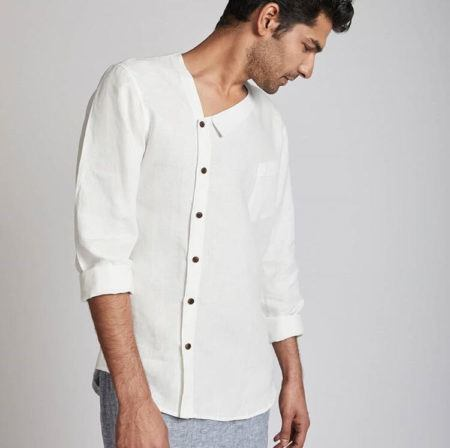 A male model poses in a long-sleeve white button down shirt made from hemp. White hemp shirt by India's first hemp-based fashion brand, BLabel. Brands and designers of all sizes are exploring hemp fabric in India.