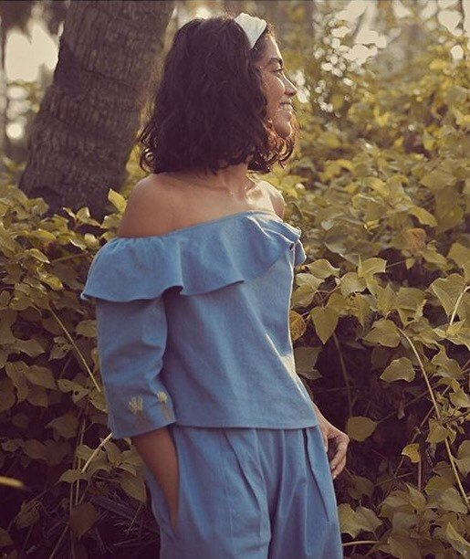 Hemp Fabric Lab allows artisans and small companies to order small amounts of hemp fabric, helping to promote hemp's acceptance in fashion at every level. Photo: A woman in a matching blue, off the shoulder shirt and pants made from hemp fabrics.