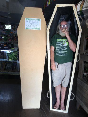 These hemp coffins are handmade at the Hemp Embassy in Nimbin, New South Wales, Australia. Photo: A man smokes a joint while standing in an undecorated hemp coffin, at the Hemp Embassy in Nimbin, New South Wales, Australia.