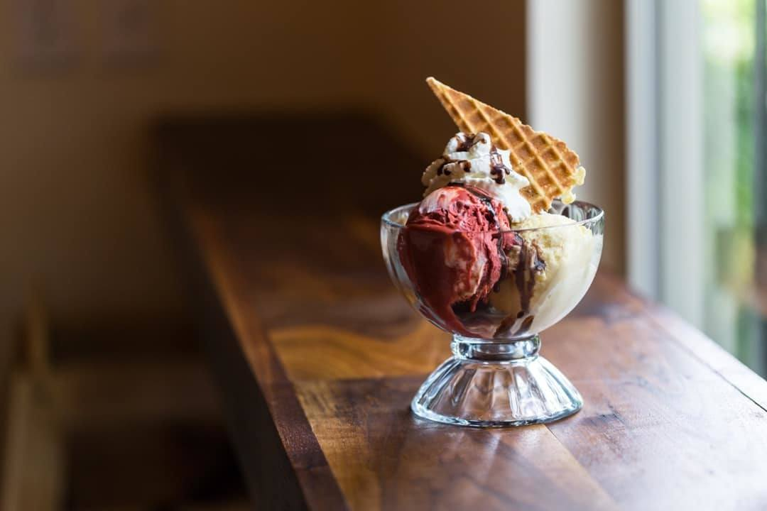 We loved trying CBD ice cream at Prohibition Creamery! Photo: A sundae made with Prohibition Creamery's CBD ice cream, garnished with a waffle cone piece.
