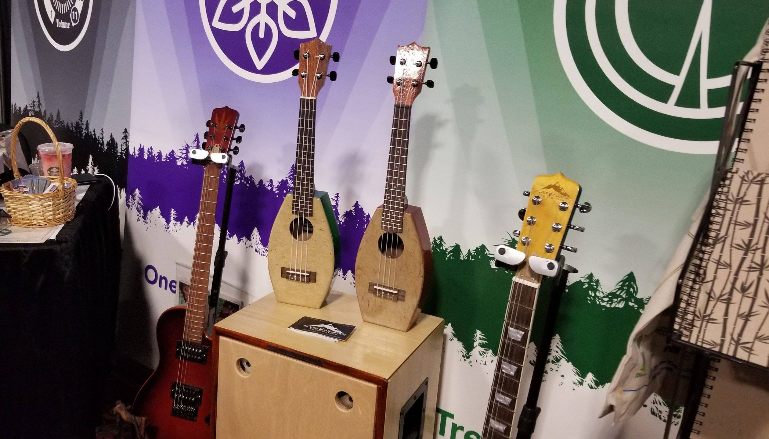 Hemp guitars and a hemp ukelele from Silver Mountain Hemp Guitars, on display at NoCo 6, the 2019 Noco Hemp Expo in Denver, Colorado.