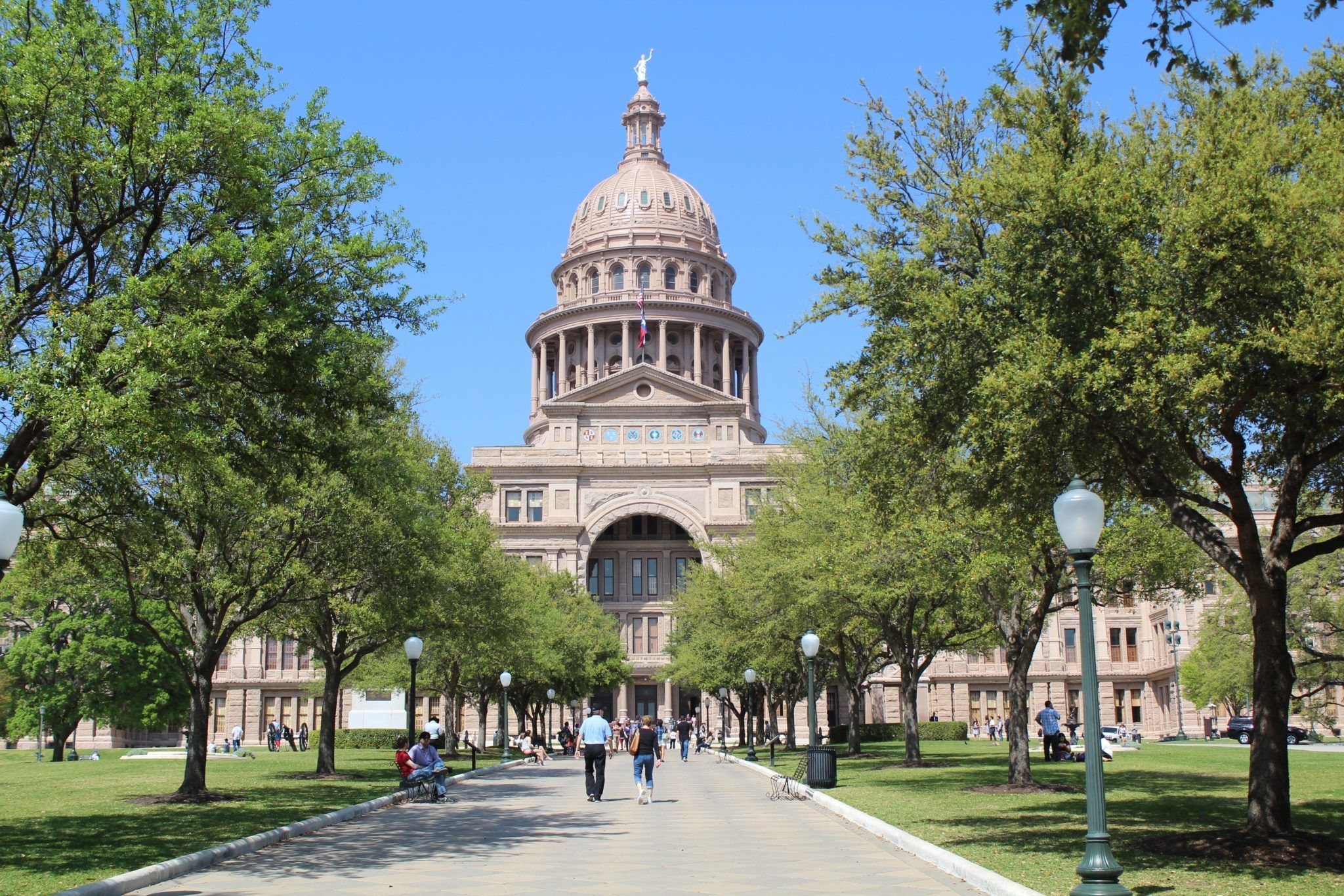 "While the 2018 Farm Bill legalized industrial hemp, Texas still needs to reform its own ""outdated"" statutes, according to attorney Dan Sullivan. Photo: People walk along the tree-lined pathway to the Texas Capitol building, home of the Texas legislature."