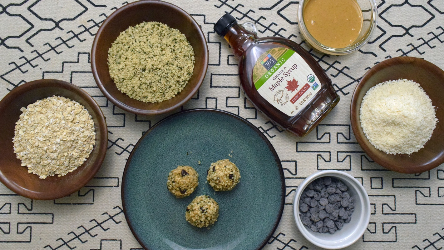Photo: Ingredients for our easy hemp recipe, no bake hemp energy balls, include hemp hearts, maple syrup, peanut butter, and dark chocolate chips.