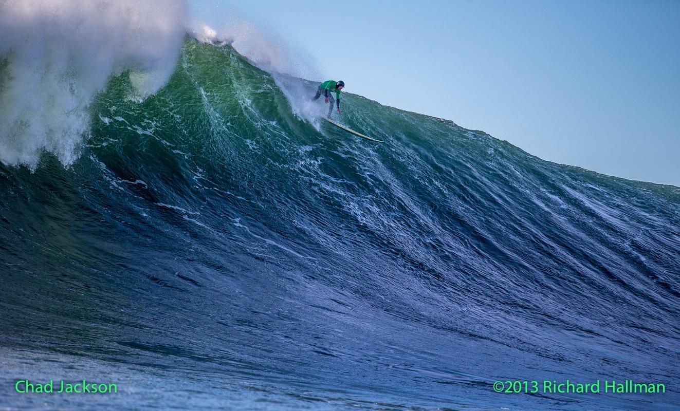Jackson catches a massive wave on a hemp surfboard.