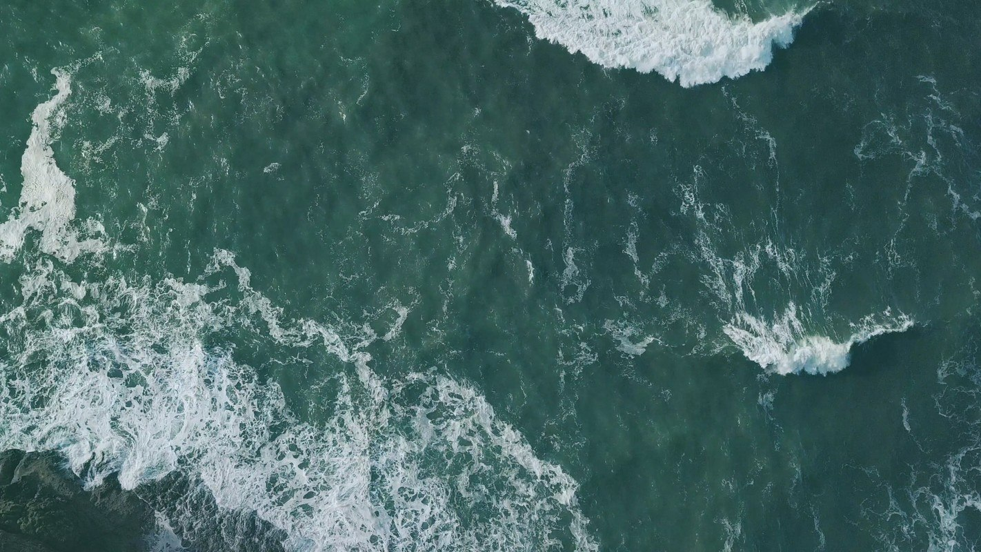 "An overhead shot of the ocean. Sana Packaging is reducing cannabis waste through reclaiming ""ocean plastic."""