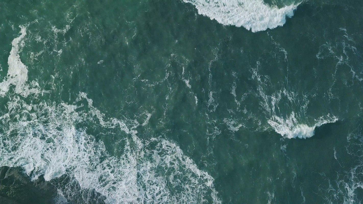"An overhead shot of the ocean. Sana Packaging is reducing cannabis waste through reclaiming ""ocean plastic."""