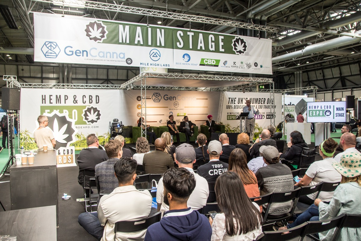Photo: The main stage at the UK Hemp & CBD Expo, with dozens of people gathered to learn about the future of hemp in the UK.