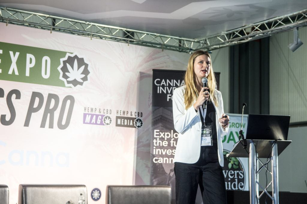 Photo: Dr. Dani Gordon speaks on the Business Stage at the UK Hemp & CBD Expo in Birmingham.