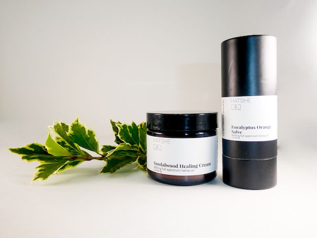 Hatshe Topical CBD with a sprig of holly.