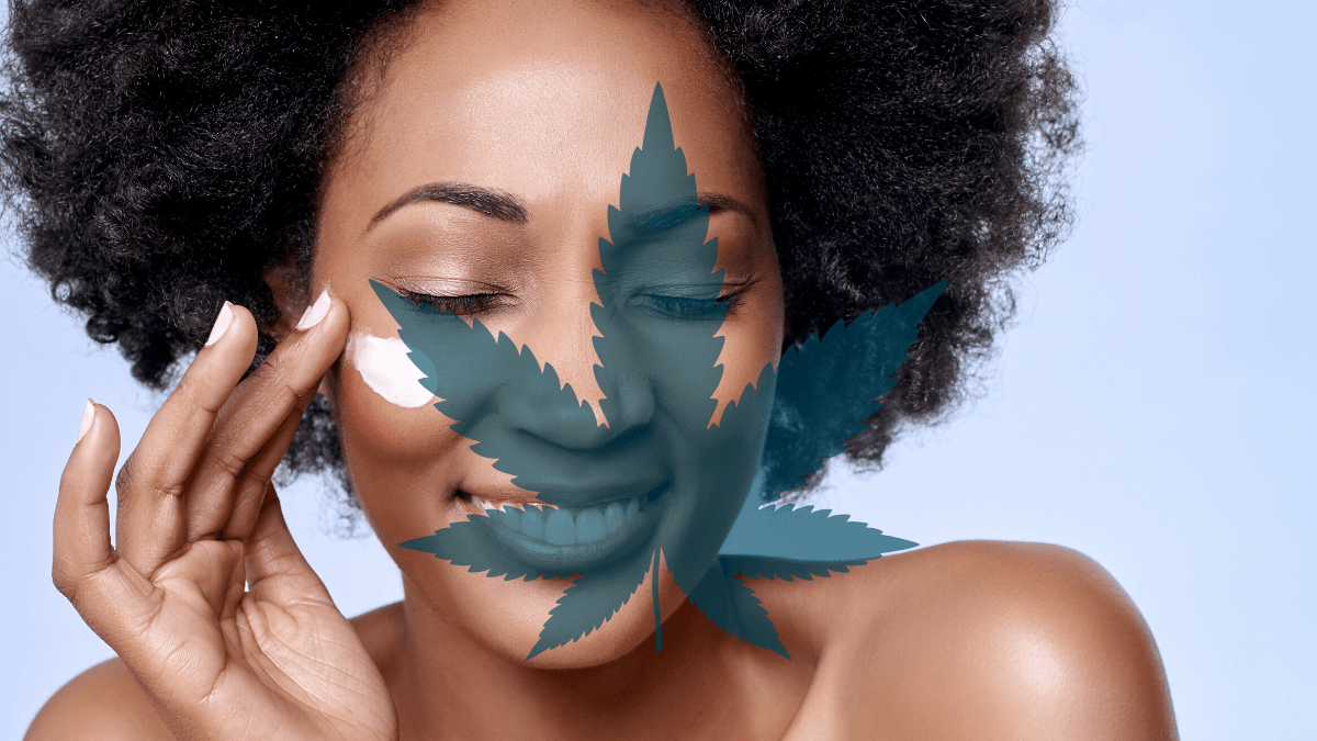 Ministry of Hemp selected the best CBD skin care and hemp beauty products out of dozens on the market. Photo: A black woman with natural hair smiles as she applies a skin care product to her cheek. A hemp leaf is superimposed on the image.