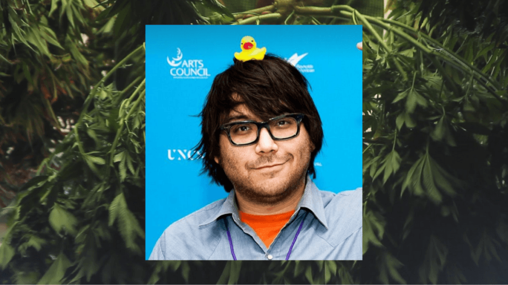 Photo: A composite image of hemp documentary creator Josh Harney, a smiling man with brown hair, a light beard and big dark glasses, with a rubber duck on his head. In the background, a photo of a freshly harvested hemp plant..
