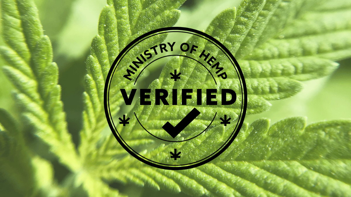 A close up of a hemp leaf, superimposed with the circular Verified By Ministry of Hemp logo.
