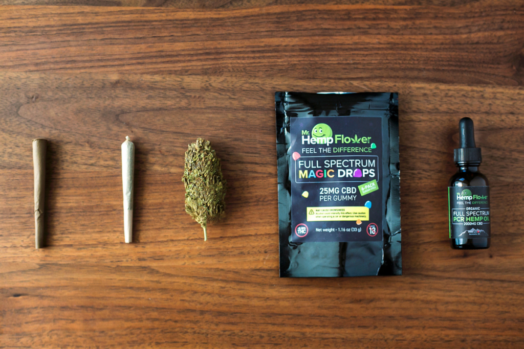 An array of hemp flower products on a wooden tabletop