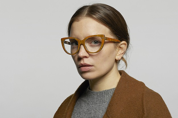 "A woman in ""turmeric"" colored cats-eye style glasses made from hemp, by Hemp Eyewear Edinburgh."