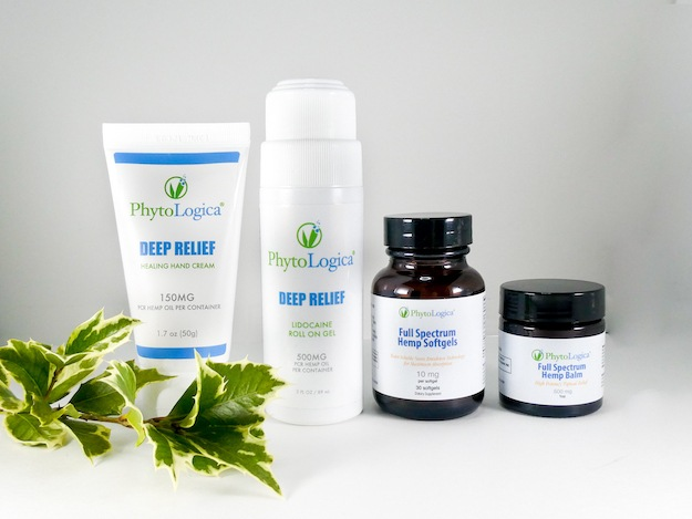 PhytoLogica Deep Relief bundle with three topical CBD products plus softgels, decorate with a sprig of ivy.